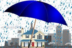 casa coperta da un ombrello